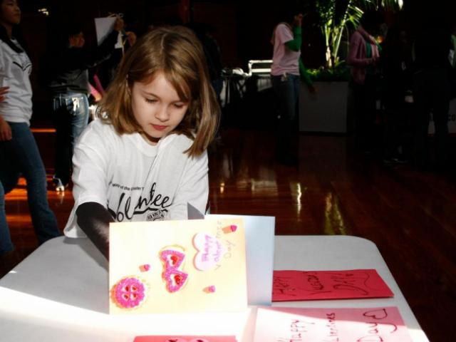 8-year-old Bailey works on making a Valentine&#039;s Day card for troops during the United Way&#039;s Martin Luther King Jr. Day of Service at the American Tobacco District in Durham.<br/>Photographer: Jerome  Carpenter