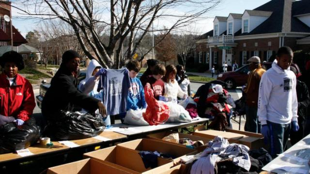 Volunteers sort and organize clothes during the United Way's Martin Luther King Jr. Day of Service at the Christ United Methodist Church in Chapel Hill.