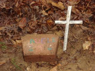 Amid the rubble of a Wake Forest home that burnt to the ground Friday night lies a small but precious grave, built for an Italian Greyhound named Adele that didn't survive the fire. After extinguishing the blaze, firefighters buried the dog in the backyard, fashioning a cross from debris and placing a brick marker with Adele's name.