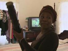 Raleigh woman attacks intruder with bedpost
