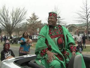 Grand Marshal Chuck Davis rides along Fayetteville Street at the 10th annual MLK Black History Month parade in Durham.