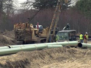 Piedmont Natural Gas is laying a 38-mile pipeline across Johnston and Wayne counties to deliver gas to a Progress Energy power plant near Goldsboro.