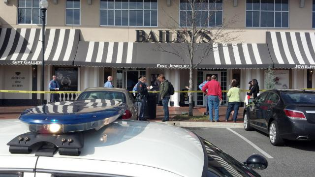 Raleigh police investigate an armed robbery at Bailey's Fine Jewelry, 415 Daniels St. in Cameron Village, Friday, Feb. 17, 2012.