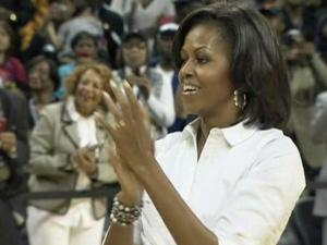 With the CIAA college basketball tournament as a back drop, first lady Michelle Obama showed off some moves of her own Friday in Charlotte.