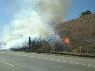 A brush fire burns off Interstate 540 at Hodge Road near Raleigh on March 6, 2012. (Photo courtesy of Lorena Aguilar)