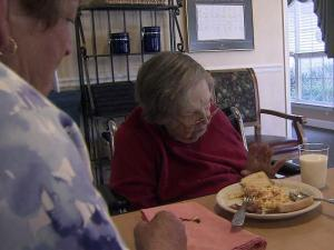 Mattie Davis, 93, suffers from Alzheimer's disease and is among thousands of North Carolina residents who receive Medicaid-funded personal care services in an adult group home.