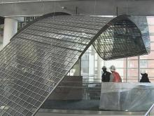 Museum addition features undulating screen