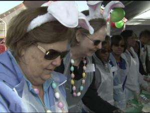 Volunteers in bunny ears dish up an early Easter meal at Durham Rescue Mission.