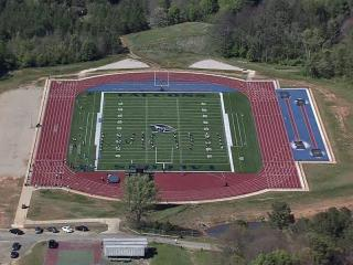 Sky 5 aerial image of the football stadium at St. Augustine's College