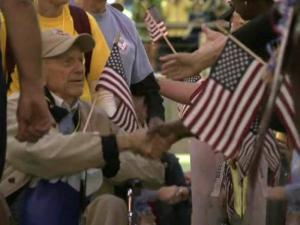 A huge crowd of people greeted about 100 local World War II veterans when they arrived at Raleigh-Durham International Airport from the eighth and final Triangle Flight of Honor trip to Washington, D.C.