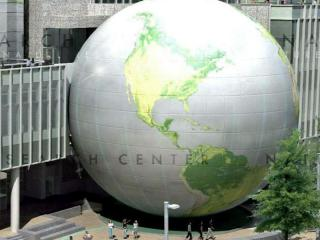 The SECU Daily Planet dominates the streetscape outside the new Nature Research Center.