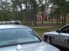 Crime scene tape surrounds a home on Wolfelee Drive in Fayetteville on April 27, 2012, where the body of a man was found.