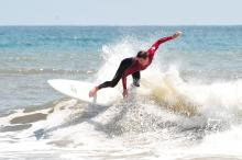 This surfer enjoys the nice weather in Buxton NC in late spring 2012.