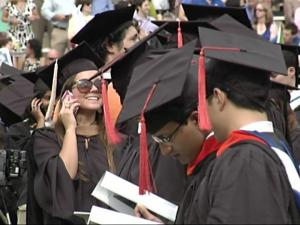 Members of the Duke University Class of 2012 file in to Wallace Wade Stadium.