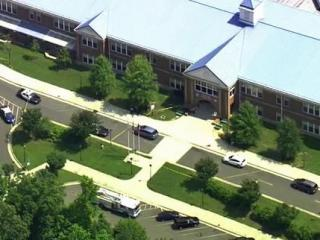 Chapel Hill police respond to a reported shooting at Mary Scroggs Elementary School on May 25, 2012.