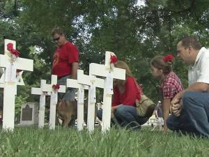 White crosses and Stars of David representing fallen warriors dotted the grounds of the State Capitol Building in downtown Raleigh.