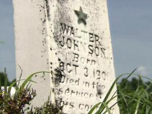 A former Marine found this headstone, belonging to a World War I veteran who died in France, in a sandy, desolate field in Sampson County.