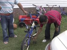Daniel Brito's parents are keeping the bike he was riding in their yard as they let go of their boy.