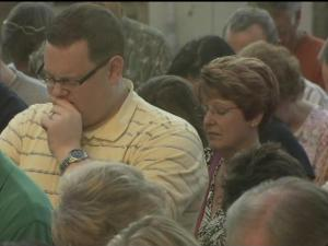 More than 100 people gathered Friday to pray in public in Louisburg for graduating seniors.