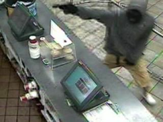 Surveillance images of an armed robbery at a Clinton Hardee's restaurant on May 18.