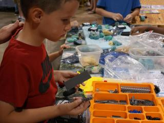 A young maker chooses parts to assemble a robot.