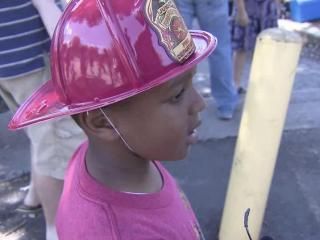 Junior firefighters lined Fayetteville Street for a parade of fire vehicles old and new.