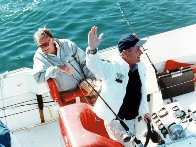 Rev. Billy Graham and President George H.W. Bush enjoy a fishing trip off the coast of Maine. (Photo courtesy of Billy Graham Evangelistic Association)
