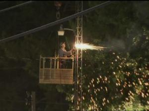 Crews worked through the night to carefully take down a communications tower in Smithfield after a cable snapped.