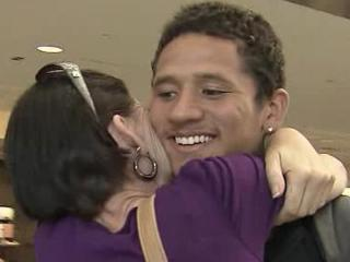 Fayetteville native Derrick Poage reunites with his mother, Tammie Brown, of Fayetteville, at Raleigh-Durham International Airport on Thursday, July 26, 2012. Poage nearly died in a mass shooting at an Aurora, Colo., movie theater early Friday, July 20, 2012.