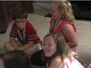 Three Garner children received medals from mayor Ronnie Williams last week after their quick thinking may have saved a dad's life.
