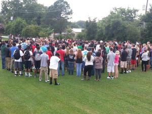 Hundreds of friends, family and community members attended an emotional last-minute vigil Monday evening for three recent graduates of Clayton High School who were killed in a Raleigh crash this weekend.