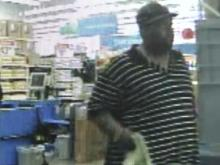 Surveillance image of a suspected purse snatcher at a Roxboro Walmart.