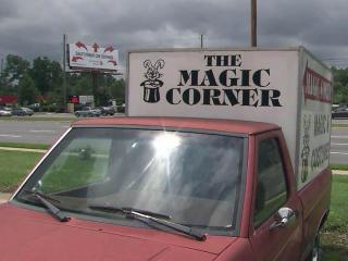 The owner of the Magic Corner parks a truck at the Capital Boulevard shopping center where the shop is located to raise the store's visibility.