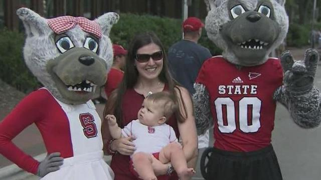 Students, alumni and fans crowded a Hillsborough Street alive with music, dance and sports demonstrations Saturday to celebrate North Carolina State University's 125th anniversary.