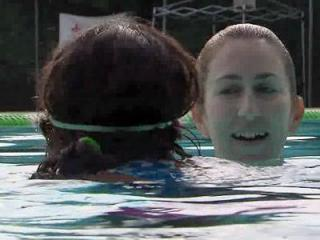 Raleigh police officer Kelly Ann Kinney is taking time this summer to teach children how to swim.