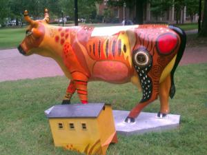 """Four people upended the """"Cow House"""" sculpture on East Franklin Street near McCorkle Place in CHapel Hill on Aug. 23. 2012, despite a 400-pound concrete block anchoring the artwork to the ground, officials said."""