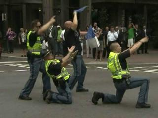 """The """"Dancing Deputies"""" are all the rage of an Uptown Charlotte intersection, lightening the often stern mood of the extensive security during the Democratic National Convention."""