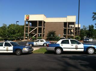 Raleigh police investigate a death at Super 8 Hotel on New Bern Avenue on Sept. 26, 2012.