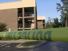 Crime scene tape surrounds a Raleigh Super 8 motel, where a 2-year-old boy was found dead Sept. 26, 2012.