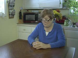 A 71-year-old Spring Lake woman escaped injury Wednesday after a man busted into her home, held a knife to her throat and robbed her of $700 in cash.