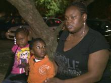 Carlota Brown with her two children on the night of the car fire.