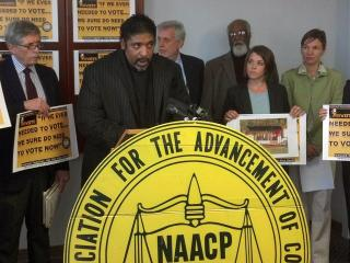 North Carolina NAACP President Rev. William Barber speaks to reporters in Durham on Nov. 5, 2012, about reports of voter intimidation at early-polling sites.