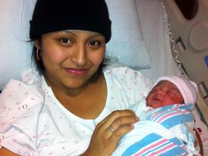 Elizabeth Aguilera Lopez holds her daughter, Emily, in UNC Hospitals on Nov. 8, 2012. Lopez gave birth the previous day at a Chapel Hill bus stop with the help of UNC-Chapel Hill graduate student Emily Brewer.