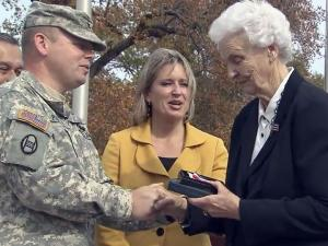 Doris Bullock Gardner receives a Purple Heart during a Nov. 12, 2012, veterans observance that her father, Pfc. Noah Bullock, won while fighting in France in World War I.