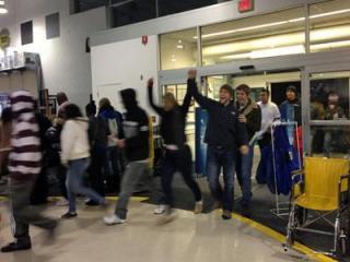 Shoppers file into the Garner Best Buy Friday, Nov. 23, 2012.