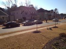 Police investigate a shooting Monday at a home on Hidden Stream Drive in Holly Springs.