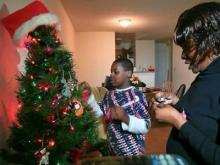 12/10: 'Coats for the Children' family giving back
