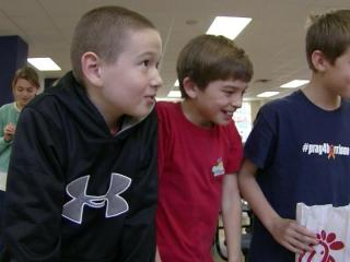 Harrison McKinion, left, treated his classmates at North Raleigh Christian Academy to lunch on Dec. 11, 2012, to thank them for their support while he battled cancer.