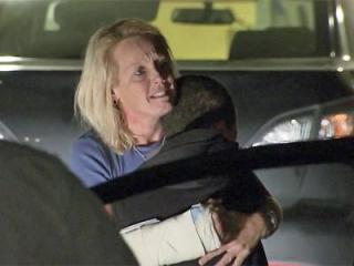 Karen Gardner Joyce hugs her son, Pacen Joyce, on Dec. 13, 2012, after authorities issued an Amber Alert for the boy, claiming that Joyce had abducted him. The pair were at their Raeford home the whole time.