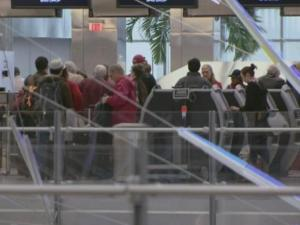 Passengers use ticket kiosks at Raleigh-Durham International Airport.